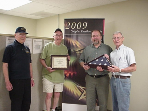 From L to R Maury Crotteau, Al Lundgren, Ed Viveiros and Bob Ledoux.  Maplewood Machine was presented a flag that was fl